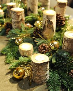 Create a warm, woodsy holiday display of richly textured candles using natural birch branches.
