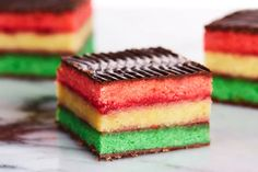 The Ultimate Italian Rainbow Cookie Recipe - - Layers of almond cake are sandwiched with raspberry jam before getting coated in chocolate for the prettiest and most delicious rainbow cookies you've ever had. Italian Cookie Recipes, Italian Cookies, Italian Foods, Italian Desserts, Italian Rainbow Cookies, Italian Rainbow Cookie Cake Recipe, Cake Recipes, Dessert Recipes, Picnic Recipes