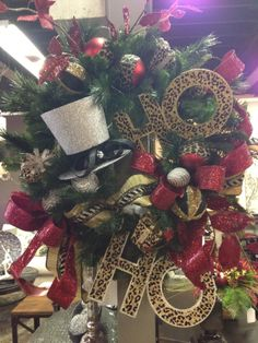 Ho Ho Ho wreath with top hat and animal print!