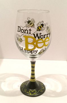 Hand painted wine glass with Dont Worry Bee Happy on the front and bees all around. Glass measures approximately 9 tall and holds 20 oz. Hand