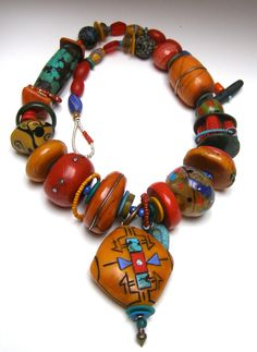 Necklace | Tory Hughes.  Berber Queen.  Another in the Trebizond Collection: a lineage of luxurious imitative assemblage necklaces, referencing the antiquities of the High Atlas mountains.  Tory's beads (predominately polymer clay) include the large amber, coral, turquoise, and jade polymer beads: also included is a fabulous handblown glass bead by Bob Miller.