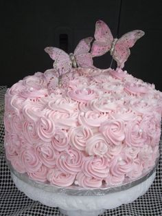 pink rose cake - pink buttercream roses and butterflies.  Love the pearls too