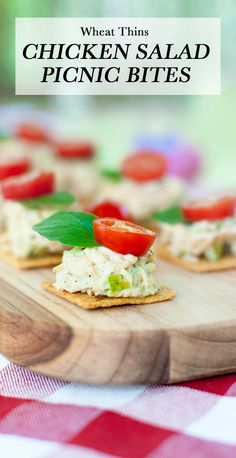 WHEAT THINS Chicken Salad Picnic Bites- Easy to make with your kids and delicious enough to satisfy everyone's taste buds. Scoop roasted chicken salad onto WHEAT THINS and garnish with an oregano leaf and tomato slice. Instant picnic perfection!