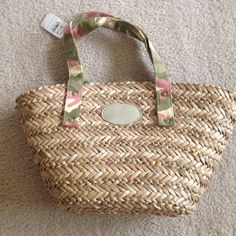 Neiman Marcus straw purse w/pink camo straps. Brand new Straw Neiman Marcus bag. Perfect summer accessory!! Neiman Marcus Bags