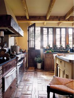 Mediterranean farmhouse style kitchen in Arizona. Perfect cabinet style. Windows above sink with plant shelf. Soapstone counters(?). Oz Architects.