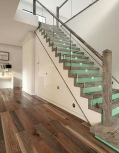 Nice way to have the stairs using a different wood than the floor does