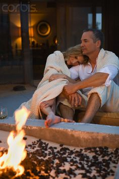 Couple sitting at fire pit
