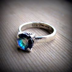Mystic Topaz and Sterling silver. Handmade by Foxy Girl Boutique