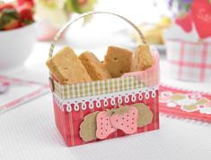 Present homemade biccies in this summery strawberry basket