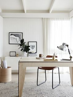 The key to having an open, airy desktop workspace is keeping your color palette minimal and limiting your furniture and accessories to a few well designed pieces.