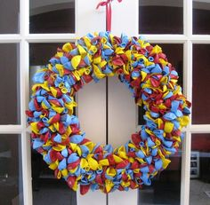 Dr. Seuss inspired balloon wreath.  Would be cute made out of fabric too.  DIY project!