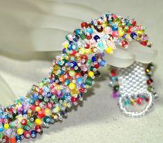 Arm Candy ... Caterpillar Bracelet . Colorful Jewelry . Fringed . Beadwoven . Bold . Multicolor . Festive . Rainbow . Brilliant . Lush. $125.00, via Etsy.