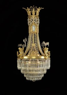 An Important Louis XVI Style Cut-Glass and Gilt-Bronze Mounted Chandelier with Wedgwood Style Porcelain Plaques (Ref: The chandelier contains four putti holding a rod of cut-glass drops, such as the one seen here. Antique Chandelier, Chandelier Lighting, Crystal Chandeliers, Bronze Chandelier, Glass Chandelier, Lamp Light, Light Up, Luxury Lighting, Louis Xvi