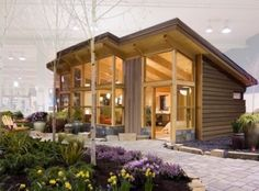 pre fab small home, love this minimalist style.....kids don't need rooms....go outside!