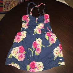 Navy A&F Flower Dress Sz M Cross Back Navy Abercrombie & Fitch Cross back flower Dress Size M. Stretchy fabric around the back. Empire waist. From the bottom of the chest to the bottom of the dress is about 17 inches. Cute dress just doesn't fit my chest anymore. No trades, no holds, no non-PM transactions. Reasonable offers considered via the offer button exclusively. Bundles 10% off (exclusions apply). ASK ABOUT MT MOVING SALE!! Abercrombie & Fitch Dresses Mini