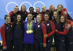 2016-08-19 USA's Women's Water Polo Gold Team hang all of their medals on coaches neck, first I've ever seen