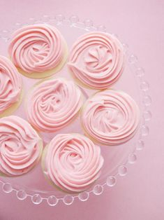 These vanilla bean sugar cookies would be a delicious addition to any wedding dessert table. Adorned with swirls of pink cream cheese frosting, they look like beautiful roses.