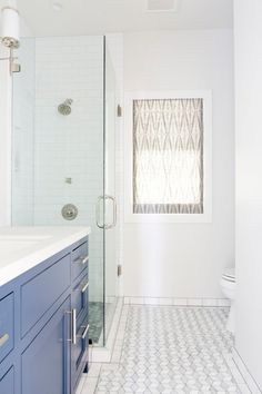 subway tile in shower with light grey grout. San Francisco Home Remodel - Megan Bachmann Interiors
