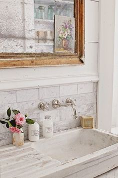 Gorgeous French Inspired Bathroom Remodel (see the before picture!) - including an antique French stone sink, wall-mounted Rohl Faucet and Carrera white marble subway tile backsplash - Dreamy Whites: French Inspired Bathroom Remodel