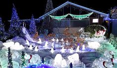 King of Christmas lights Paul Toole, at Manning Close, Wells, Somerset, England. Shows off his animated display!