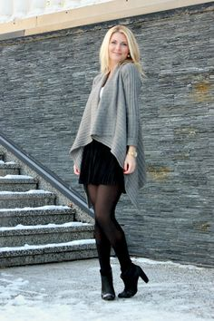 Anna-Maria wearing black skirt, white top and grey cardigan. Winter style.