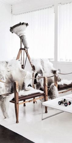 Safari chairs with furs and white industrial lamp barefootstyling.com