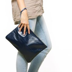 The AM:PM Clutch in Navy  I designed the AM:PM Clutch to be perfect from day to night. It is classic, versatile and great to carry personal items.