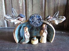 This teeny tiny heirloom quality Nativity set is ready to be wrapped up and sent to your home. Each piece was sculpted by hand from a speckled stoneware clay and then fired, glazed, and fired again. The backdrop measures about 3.5 wide, just over 2.5 tall, 2 deep, and each figurine