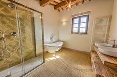 Sognando Spello. Claw foot bath, terracotta tiled shower bespoke vanity in antique wood. Turnkeyitalia.com