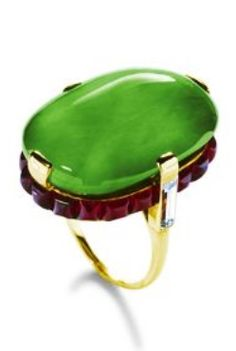 Cartier Paris - An Art Deco gold, jade cabochon, diamond and ruby ring, circa 1934. Created by Cartier Paris at the request of Barbara Hutton in 1934. #Cartier #ArtDeco #ring #BarbaraHutton
