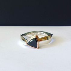 A new local Oberon Sapphire ring. A dark 1.1ct trilliant stone in a 14K Red Gold bezel and hand forged trilliant shaped Argentium Silver band (very comfortable to wear! ) Available from the Bathurst Regional Art Gallery from tomorrow.  #foxartisticcreations #jeweller #goldsmith #bathurstnsw #regionalnsw #oberonsapphire #JewelryADD #handcrafted #sapphire #partisapphire #sapphirering #oberon #rosegold #handforged #handmade #unique #ring #argentium #silver #nocasting