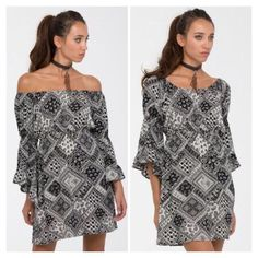 """Lovely Printed 2-Way Bell Sleeve Dress NWT  Black & White Bell Sleeve Dress. New with tags. Versatile -- can wear on or off shoulders. Fabric is rayon. Size large.                        ❌TRADES ❌ LOWBALL OFFERS ✅ USE THE """"OFFER"""" LINK BELOW ✅ USE THE """"ADD TO BUNDLE"""" TO GET 15% DISCOUNT ON 2+ ITEMS ✅ POSH RULES Boutique Dresses Long Sleeve"""