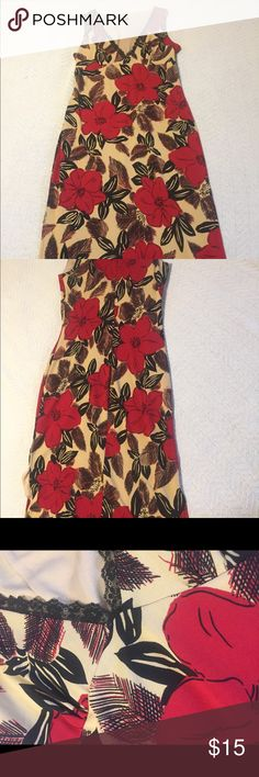 "Midi Red and Black Floral Print Dress- never worn Beautiful, romantic and Sexy Red and Black Floral Print Dress. Has black lace along V neckline. Has lining and 11"" slits on both sides. Hits me below the knee and I'm 5'3. NWT Dresses Midi"