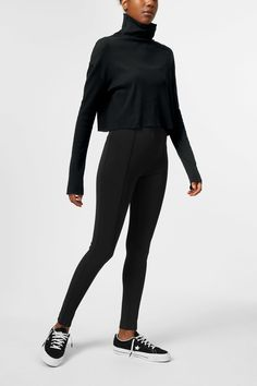 The Philippa Long Sleeve T-shirt is a boxy cropped long sleeve with a loose turtleneck. Made of organic cotton, it has a delicately ribbed structure and ra