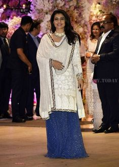 Kajol at Ambani Wedding Festivities : I like the Anjula Bhandari separates, separately because together it's became way too crowded and that Khurana Jewellery necklace only added to the fuss. Although, her smile certainly made things slightly better! Trendy Dresses, Trendy Outfits, Indian Actress Hot Pics, Indian Designer Suits, Indian Party Wear, Lehenga Designs, Dress Picture, Pakistani Dresses, Bollywood Fashion
