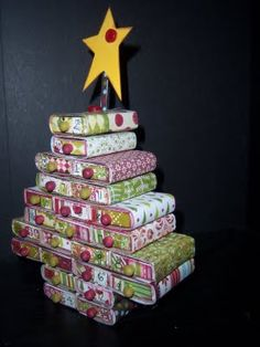 Matchbox Advent Calendar - Save those mini matchbooks or buy a package at the dollar store. Festive scrapbook paper makes this project even more festive. #tutorial