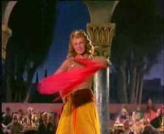 The Princess Salome dances for King Herod in exchange for him giving her anything that she wants. Rita Hayworth as Salome in a scene from the movie Salome. Ms. Hayworth is so gorgeous and sultry in this scene.