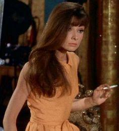Audrey Hepburn holding a cigarette in Paris When it Sizzles ; hair down