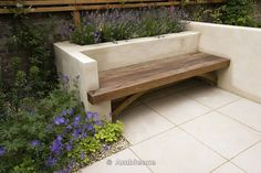 built in bench plants .... behind but not too intrusive .... cosy looking ... plants down to the ground?