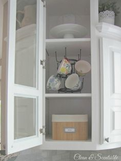 Great post on how to organize kitchen cabinets.  Lots of ideas!...I hunk PB has this hanger...geat idea for colorful cups!