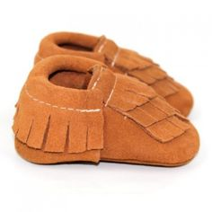 Deer One moccasins are made entirely of 100% genuine leather, and feature elasticated opening to keep them secure on your little ones feet. These gorgeous soft soled moccasins are the perfect shoe to take your baby from sitting, to crawling, to walking.  Sizing: Measure your child's foot from heel to the tip of their big toe and add 1/2 inch or approx 1.2cm for growing/wiggle room and then choose the closest size.  Sizing Guide:  + 4.0 inch - 10cm approx 0-6 months  + 4.5 inch - 11.4cm…