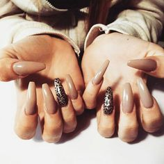 Brown and black design, squoval nails :)