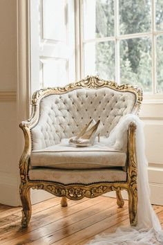 Ornate vintage chair + Jimmy Choo's + a whisper soft wedding veil. Is there anything more elegant?