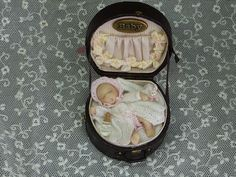 Little girl in a hatbox