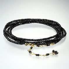 """Proclaim your original sense of style with an Anne Sportun wrap bracelet! Brilliantly layered with an 18k gold hex bead, and sparkling black spinel beads, this is a bracelet that is coveted by jewelry collectors around the world. A truly versatile piece that can also be worn as a long necklace, or wrapped around twice for a shorter layered look.<br><br>Bracelet measures 34"""" with a wire wrapped 2"""" extension, and wraps around the wrist five times."""