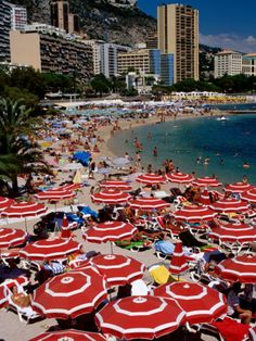Overhead of Red Sun Umbrellas at Larvotto Beach on Busy Summer's Day, Monte Carlo, Monaco Photographic Print by Dallas Stribley at AllPosters.com
