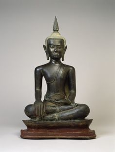Buddha at the Moment of Victory. Thai (Artist) PERIOD 14th-15th century MEDIUM leaded bronze (Metal). central Thailand (Place of Origin)