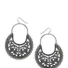 #Indiangliterrati  Give an instant doze of ethnicity to your look with crafty silver earrings. With an intricately cut-out pattern in oxidized silver metal, they can charm any outfit.  Wear with a tank top and a printed maxi skirt and Kohl eyes for an ethno-boheme chic look.