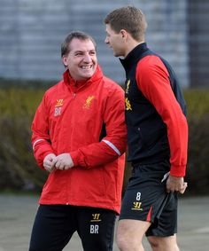 Brendan Rodgers & Steven Gerrard chat during training at Melwood. #LFC