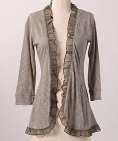 This romantic cardigan plays a perfect part in beautifully layered ensembles thanks to its feminine silhouette, sheer ruffle trim and preppy stripes.